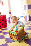 Boy plays with cube Royalty Free Stock Image