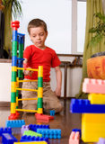 Boy plays with cubes Stock Photos