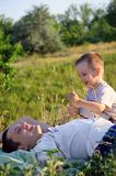 The boy plays with the daddy Stock Photography