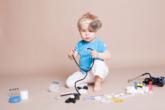 A boy plays in doctor medicine hospital stock photos