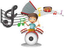 Boy plays drumset with music notes in background Stock Images