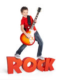 Boy plays on electric guitar with 3d text Royalty Free Stock Photography