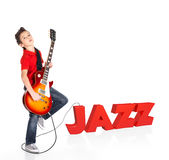 Boy plays on electric guitar with 3d text Royalty Free Stock Image