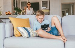 Boy plays with electronic device but his mother not happy with this royalty free stock images