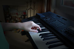The boy plays the electronic piano royalty free stock photos