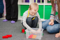 Boy plays on floor Stock Images