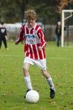 A boy plays football Royalty Free Stock Photos