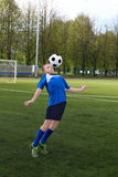 Boy plays football Stock Image