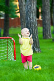 Boy plays football in park Royalty Free Stock Images