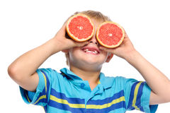 Boy plays with fresh fruit Royalty Free Stock Photo