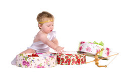 Boy plays with gift boxes Royalty Free Stock Photography