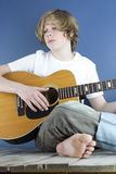 Boy Plays Guitar 3 Stock Image