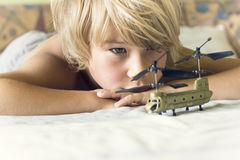 Boy plays with a helicopter Stock Photography