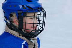 Boy plays hockey Stock Images