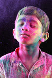 A boy plays Holi Stock Images