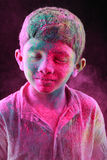 A boy plays Holi Royalty Free Stock Photos