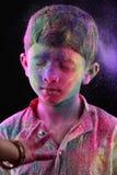 A boy plays Holi Royalty Free Stock Photo