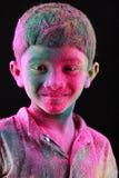 A boy plays Holi Royalty Free Stock Photos