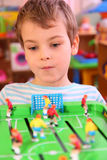 Boy Plays In Toy Football Royalty Free Stock Images