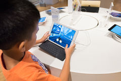 Boy plays on iPad, Kuala Lumpur Royalty Free Stock Photo