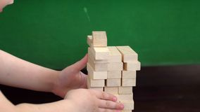 The boy plays jenga. The little boy plays jenga stock video