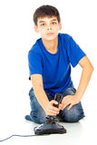 Boy plays on the joystick Royalty Free Stock Images