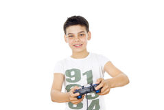 Boy plays on the joystick in the game Stock Photos
