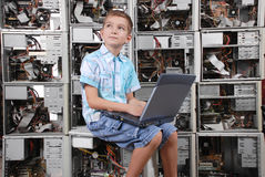 The boy plays with laptop Stock Images