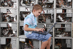 The boy plays with laptop Royalty Free Stock Photo