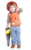 Boy plays. Little boy in the construction helmet ankle boots in hand saw.Isolated on white background royalty free stock photography