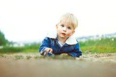 A boy plays in the sand Stock Photos