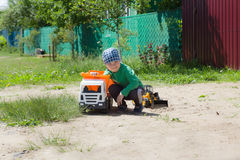The boy plays with machines on the street Stock Photography