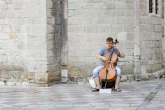 the boy plays a musical instrument on the street, editorial stock photography