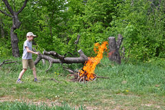 A boy plays near a fire. Royalty Free Stock Images