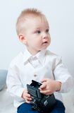 Boy plays with an old camera Royalty Free Stock Images
