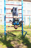 A boy plays outdoors on the playground. Playground, baby fun Royalty Free Stock Images