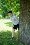 A boy plays in the park Stock Image
