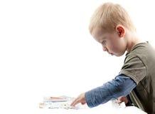 Boy plays pills Stock Images