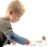 Boy plays pills Stock Photography