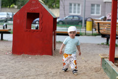 Boy plays in playground Stock Photos