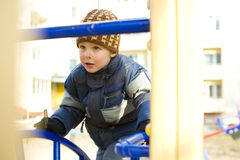 Boy plays at a playground Royalty Free Stock Images