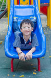Boy plays at playground Stock Images