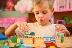 Boy plays  in playroom Stock Photography