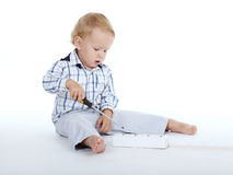 Boy plays with plug and screwdriver Stock Photography