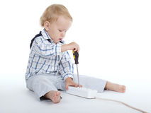 Boy plays with plug and screwdriver Royalty Free Stock Images