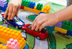 A boy plays in the room in the car. A boy plays in the room on the floor in the machine stock image