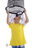 Boy plays with rubbish bin Stock Photos