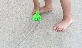 Boy plays in the sand at the beach Royalty Free Stock Photo