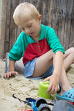Boy plays with sand Stock Photography