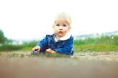 A boy plays in the sand Stock Photo